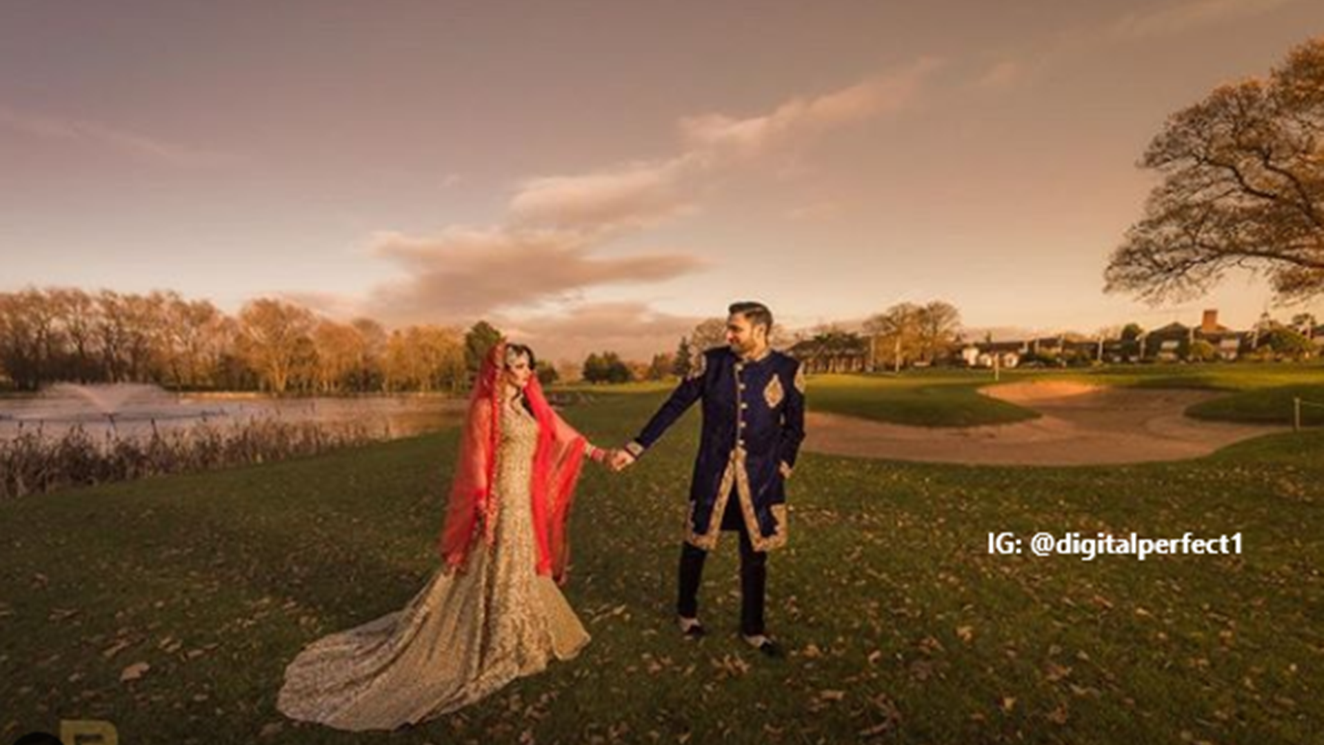 Asian couple in traditional dress celebrating having their wedding photographs taken outside of the Belfry Hotel on the golf course