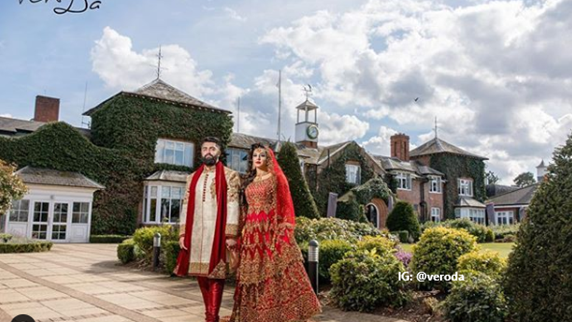 Asian couple in traditional dress celebrating their wedding day outside of the Belfry Hotel